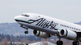 Portland, Oregon, USA - March 19, 2011: A pilot of an Alaska Airlines 737 guides his plane in to the air from runway 10 left at Portland International Airport.Alaska Airlines is a US airline