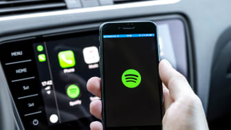 Miskolc, Hungary - May 20, 2018: Spotify starting up on an iPhone 8 connected to a new Skoda car.