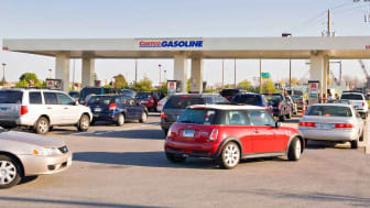 Cars line up at a Costco gas station