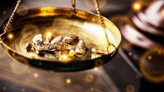 gold nuggets on a balance tray