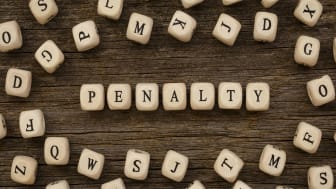 """picture of blocks with letters on them spelling out """"penalty"""""""