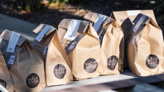 Brown bags with fresh groceries ordered online through Amazon Prime from Whole Foods Market and home delivered during the COVID-19 Shelter in Place order