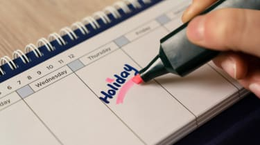 """A calendar with the word """"Holiday"""" underlined in highlighter."""