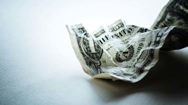 crumbled US dollar bill