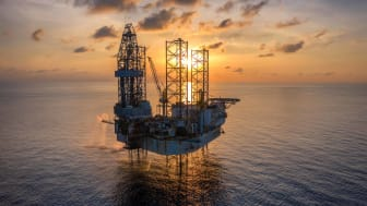 An oil rig in the sea.