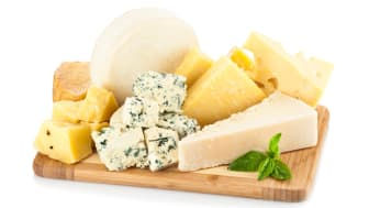 A variety of cheeses on a cutting board