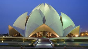 The Lotus Temple, located in New Delhi, India, is a Bah?'? House of Worship completed in 1986. Notable for its flowerlike shape, it serves as the Mother Temple of the Indian subcontinent and