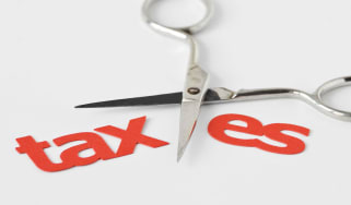 """picture of scissors cutting the word """"taxes"""" in half"""