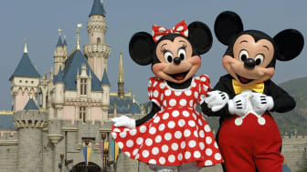HONG KONG - SEPTEMBER 1: (EDITORIAL USE ONLY)In this handout photo provided by Disney, Mickey and Minnie Mouse are seen in front of the Sleeping Beauty Castle at the new Disneyland Park on Se