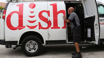 MIAMI, FL - JUNE 04:Alberto Rodriguez a Dish Network technician works around one of the company trucks on June 4, 2015 in Miami, Florida.Reports indicate that Dish Network, the satellite tele
