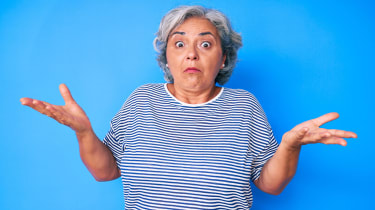 picture of confused elderly woman shrugging