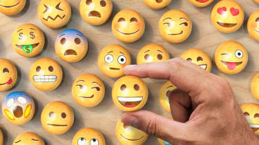 Choosing a happy face emoji from a pile of options.