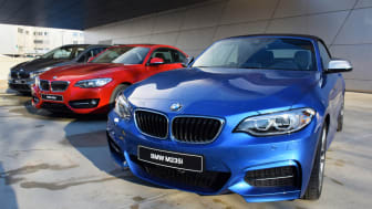 Munich, Germany - March 16th, 2016: The presentation of three differents BMW 2-series vehicles (cabriolet, coupe and minivan) on the exposition. The BMW is one of the most popular premium veh