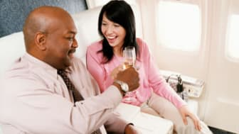 Passengers Toasting With Champagne in an Aircraft Cabin Interior