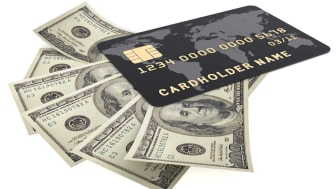 picture of a debit card sitting on cash