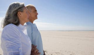 An older couple look off into the distance