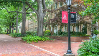 Gardens and walkway with school logo on the campus of the University of South Carolina.