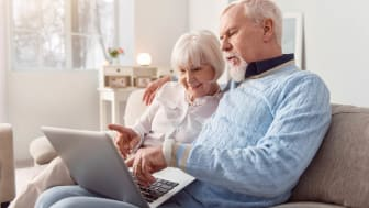 A senior couple on a laptop computer