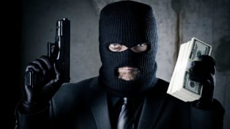 picture of robber holding gun and money
