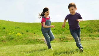 Kids chase each other.