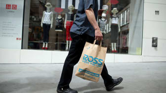 SAN FRANCISCO, CA - MAY 13:A shopper carries a bag from a Ross clothing store on May 13, 2013 in San Francisco, California.According to a Commerce Department report, falling gas prices help b