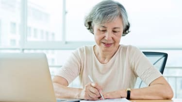 Senior woman using laptop at home.