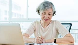 Senior woman using laptop at home.