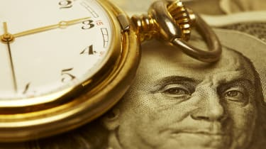 Macro shot of pocket watch face with 100 dollar bill Ben Franklin. Selective focus is on Franklin's Eyes. Gold Tone.