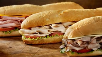 """""""Three 12 inchSubmarine Sandwiches- Turkey, Ham and Cheese, Roast Beef and Swiss with Lettuce and Tomato on Crusty Buns- Photographed on Hasselblad H3D2-39mb Camera"""""""