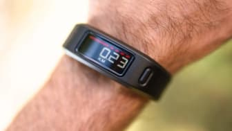 Florence, Italy - October 4, 2014: Close up of the new Garmin Vivofit on the wrist of a guy. Garmin Vivofit is the new sport fitness tracker that can allow to track your daily activity, calor