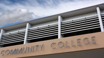 """A building sign reads """"community college"""""""