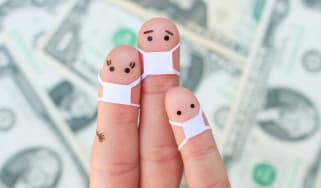 picture of three fingers made to look like a mother, father, and child in front of dollar bills