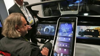 LAS VEGAS, NV - JANUARY 07: Show attendees check out a prototype of a connected car console, built with Gorilla Glass at CES 2016 at the Las Vegas Convention Center on January 7, 2016 in Las