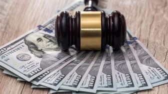 A gavel atop a spread of cash