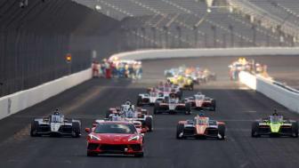 cars taking a lap at Indianapolis 500