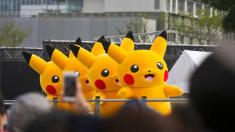 "Yokohama, Kanagawa Prefecture, Japan - August 14, 2018: Performers dressed as Pikachu marching on the street during the 5th ""Pikachu Outbreak"" in Yokohama. Over 1,500 Pikachus dance and march"