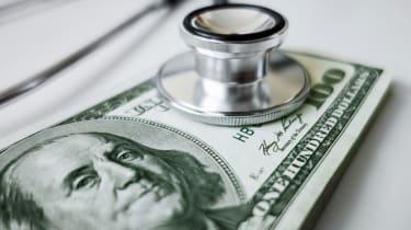 Stethoscope on 100 dollar bills symbolizing financial surveillance