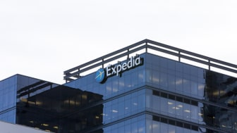 February 10, 2018 - Bellevue, WA, USA: An Expedia sign can be seen on top of a building on a sunny day