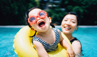 picture of mother and child playing in a pool