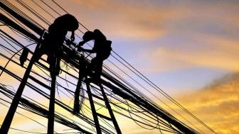 Utility workers repair power lines