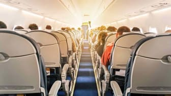A picture of the back of the seats on an airplane