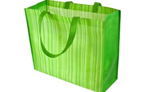 Empty green reusable shopping bag isolated on white background