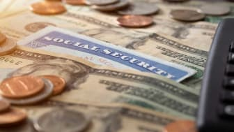 picture of Social Security card sitting on money