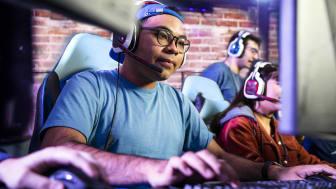 gamers wearing headphones