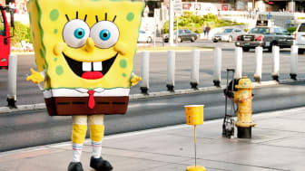 Las Vegas, USA - May 14, 2013: A man dressed up as Sponge Bob Square Pants during the day on Las Vegas Boulevard posing for photos in exchange for tips.