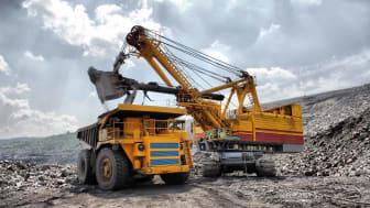 loading of iron ore into dump truck