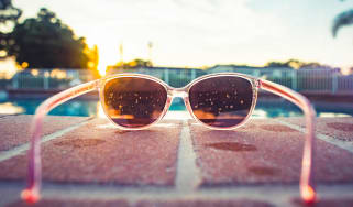 Sunglasses frame a pool scene.