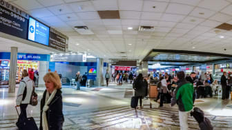 ATLANTA, GA, USA, MARCH 6, 2014 - People at intersection of two corridors connecting gates inside Atlanta International Airport on March 6, 2014 in Atlanta, GA, USA.