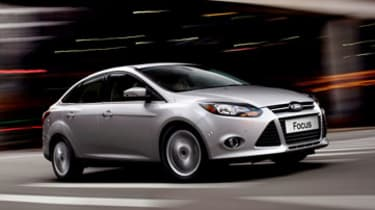 2013 Ford Focus: Ford's best-selling Focus continues the tradition of class-leading dynamics, safety and outstanding value in either four-door sedan or five-door hatchback bodystyle. (06/27/1