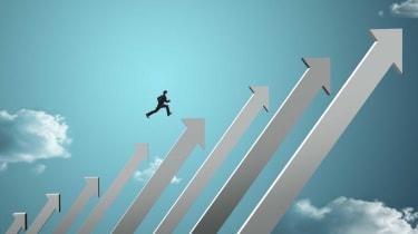 Concept art of a businessman jumping on upward-facing stock-chart arrows
